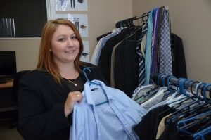 Kasira demonstrates support for Busy Beat with clothes donation